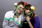 Romantic couple with roses — Stock Photo