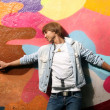 Stock Photo: Handsome mstanding near graffiti wall