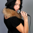 Beautiful female singer singing a song — Stock Photo #2198523