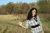 Beautiful young woman walking outdoor — Stock Photo