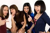 Happy four friends studio shot — Stock Photo