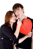 Romantic couple with red heart — Stock Photo