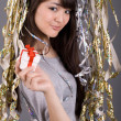 Girl standing among tinsel — Stock Photo #2341001