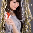 Foto de Stock  : Girl standing among tinsel