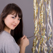Foto Stock: Girl with tinsel