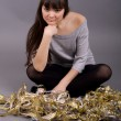 Photo: Girl sitting among tinsel
