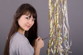Girl with tinsel — Stock Photo