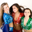 Stock Photo: Three girls belly dancing in studio