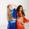 Two girls belly dancing in studio — Stock Photo