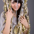 Girl standing among tinsel — Stockfoto #2491369