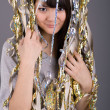 Girl standing among tinsel — Stock Photo #2491369