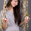Girl standing among tinsel — Stockfoto #2491501