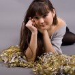 Girl lying among tinsel — Stockfoto #2501879