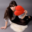 Beautiful woman holding red heart — Stock Photo