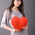 Beautiful woman holding red heart — Stock Photo #2502541