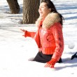 Stock Photo: Happy girl fell in snowdrift