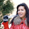 Funny girl with an icicle - Stock Photo