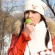 Funny girl eating apple outdoor — Stock Photo #2504775