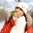Funny girl eating apple — Stock Photo