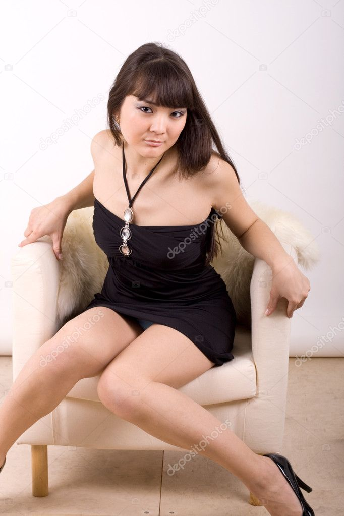 Beautiful girl sitting in an armchair   Stock Photo #2503216