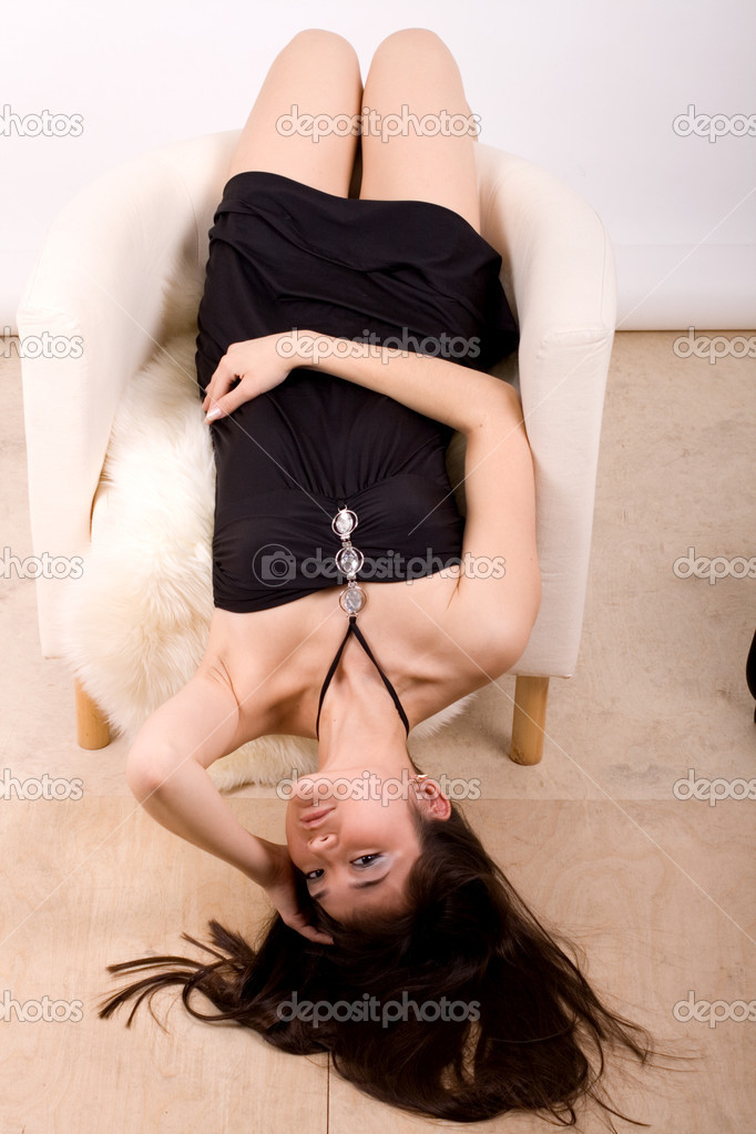 Beautiful girl lying in an armchair  — Stock Photo #2503575