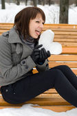 Girl holding an ice heart — Stock Photo