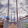 Foot-bridge with cloudy sky — Stock Photo #2183578