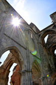 Gothic church ruin with lens flare — Stock Photo