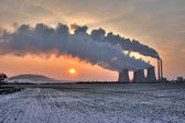 View of coal powerplant against sun — Stock Photo