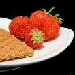 White plate with trawberry and cracker — Stock Photo