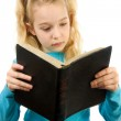 Little girl is reading the Bible — Stock Photo #2175818