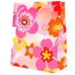 Plastic shopping bag with floral motif — Stock Photo