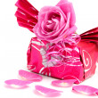 Beautiful wrapped gift with rose - Stock Photo