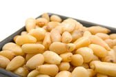 Little bowl with pine nuts — Stock Photo