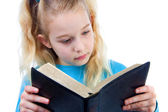 Little girl is reading the Bible — Stock Photo