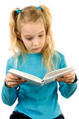 Young girl is reading a book — Stock Photo