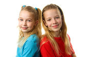 Two young girls looking in camera — Stock Photo