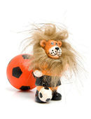 Orange soccer ball and lion — Stock Photo