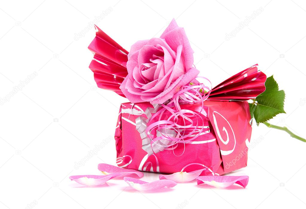 Beautiful wrapped gift with rose for birthday or valentine's day over white background  Stock Photo #2177832