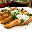 Grilled salmon with cheese and herbs - Stock Photo