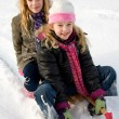 Two girls on a sled — Stock Photo