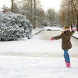 Girl is throwing snow ball — Stock Photo
