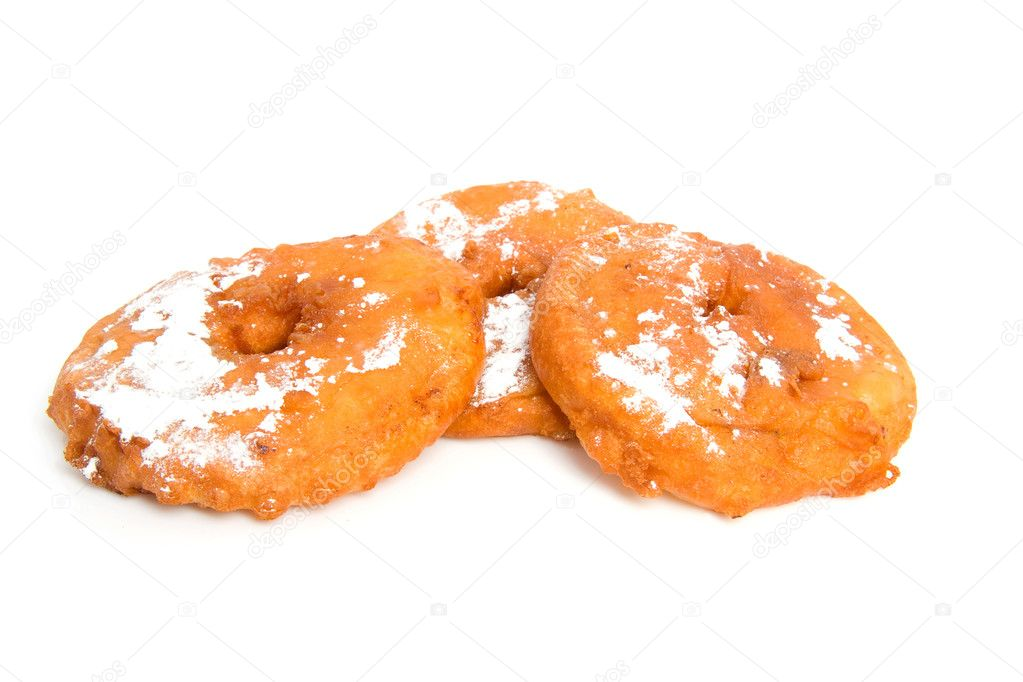 Three fresh home baked appelflappen ( apple fritter), typical dutch food  on New years eve. isolated on white background — Stock Photo #2206844