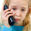 Sad girl on the phone - Stock Photo