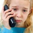 Sad girl on the phone — Stock Photo