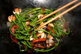 Preparing dinner in wok pan — Stock Photo
