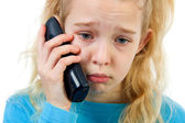Sad girl on the phone — Stock Photo