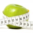 Green apple with measure-tape — Stock Photo #2379729