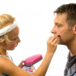 Girl is putting makeup on bij father — Stock Photo