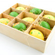 Nine painted easter eggs in a box - Stock Photo